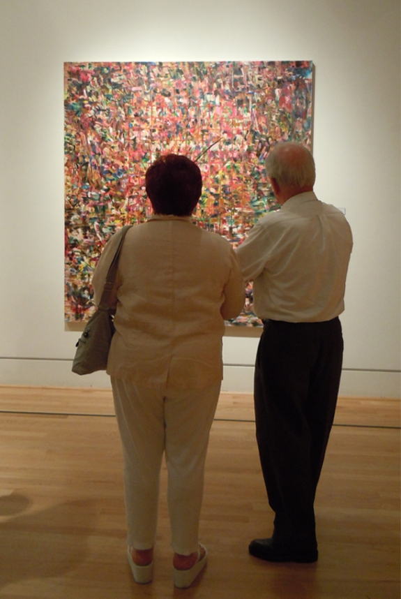 Observers viewing my painting at the Triton Museum